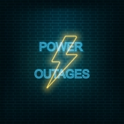 What is the difference between a blackout and a brownout in electricity terms?